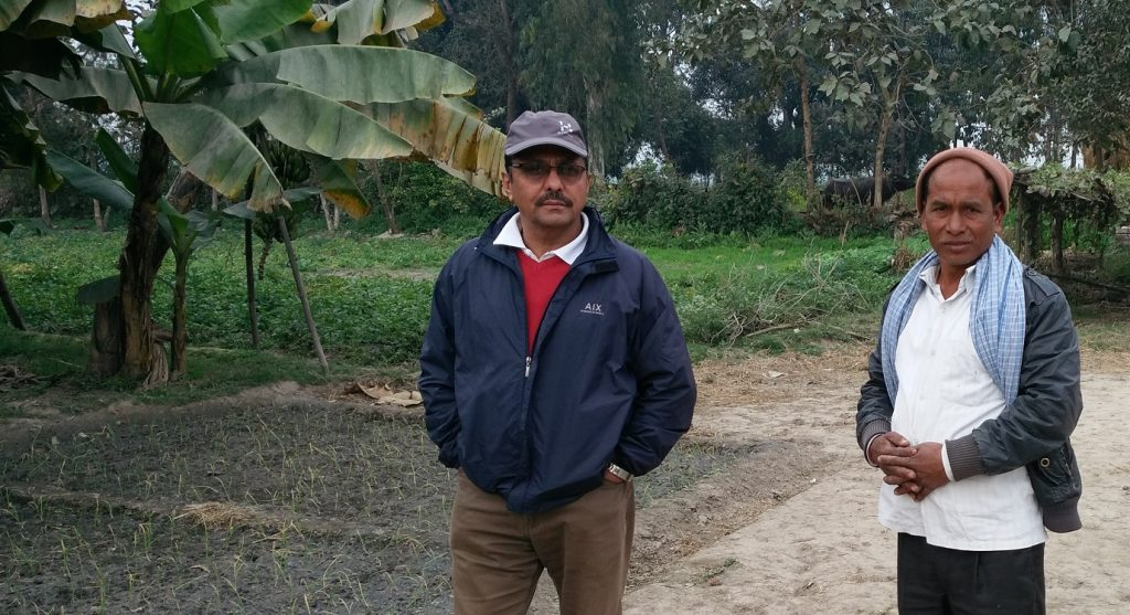 Mr. Sita Man Tharu and Mr. Prem Thapa discussing his Banana plantation