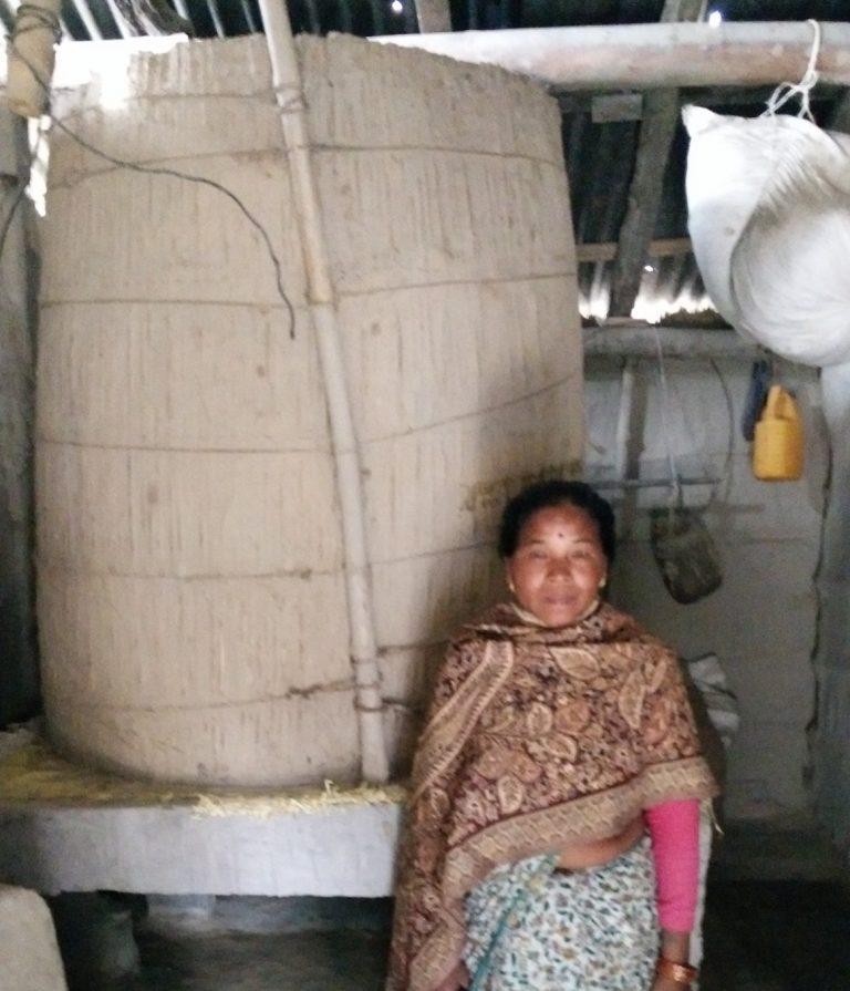 Mrs Mana Kumari Tharu and her elevated rice store