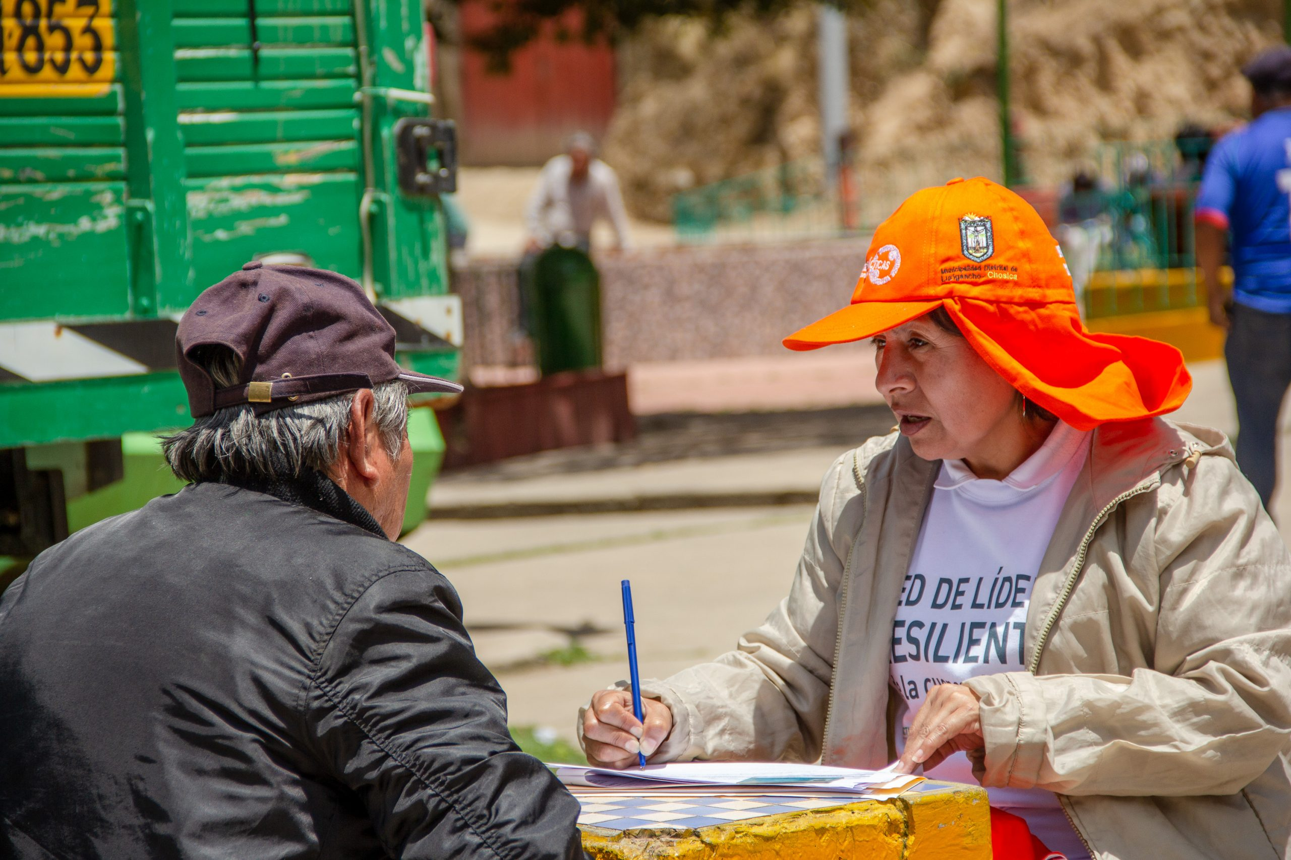 Eva, a member of a local partnering organisation, interviewing community member as part of Practical Action's FRMC data gathering. Photo: Giorgio Madueno, Practical Action.