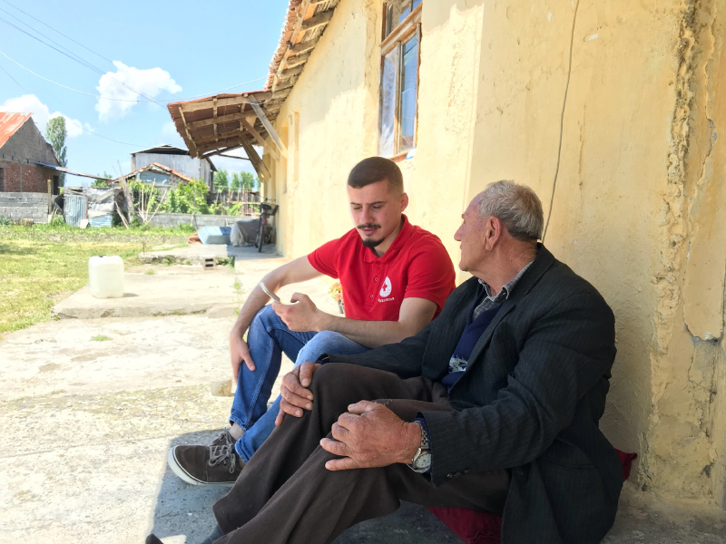 Said interviewing a community member as part of the FRMC data collection. Photo: Albanian Red Cross.