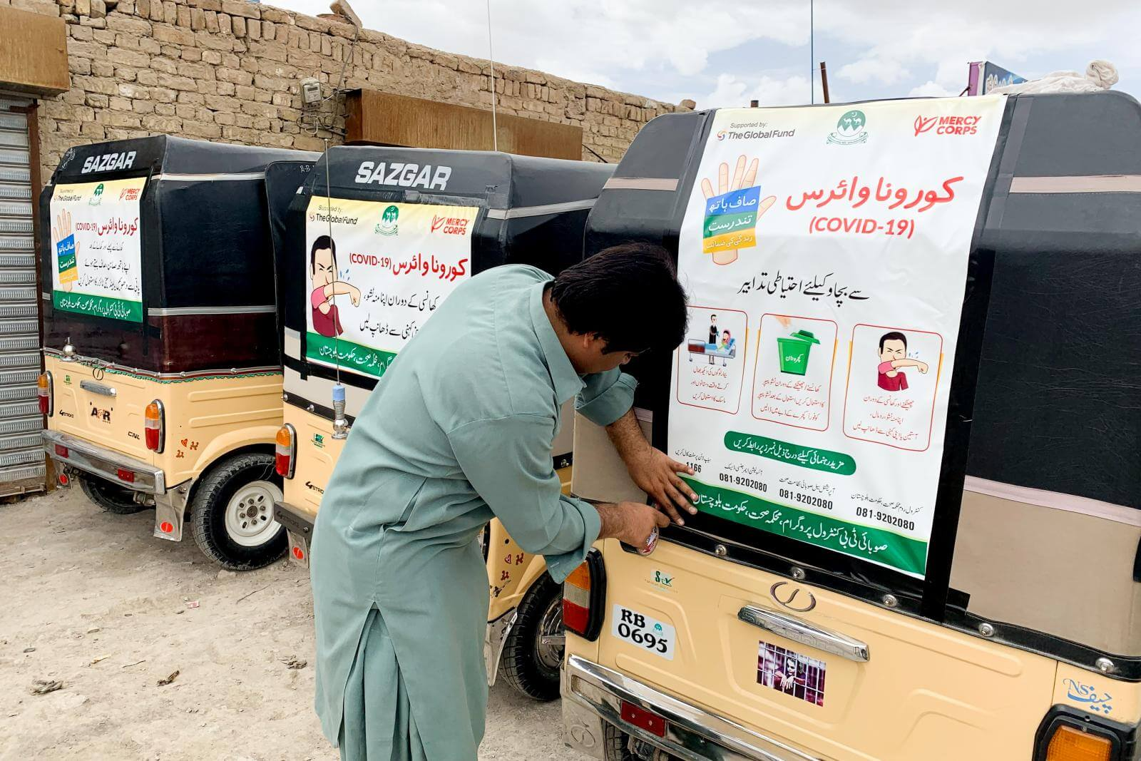 Mercy Corps using tuk tuks to display and share guidance that help reduce the spread of COVID-19 in Pakistan.