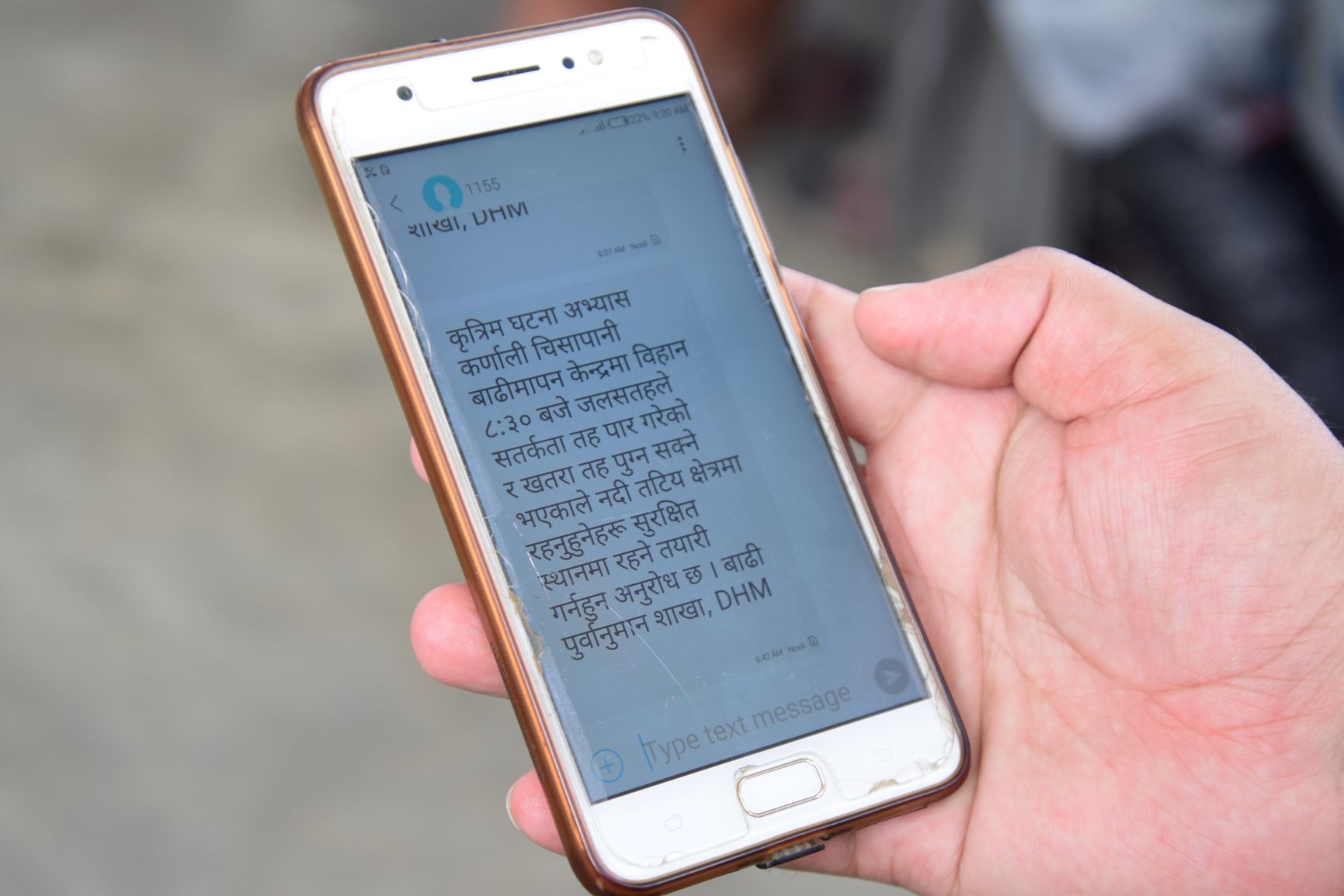 Flood early warning message in Nepalese. Existing systems can be used to share information and advice around COVID-19. By Archana Gurung, Practical Action