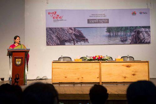 Zakia talking at a photo exhibition opening on Climate Change Adaptation, Dhaka, Bangladesh.