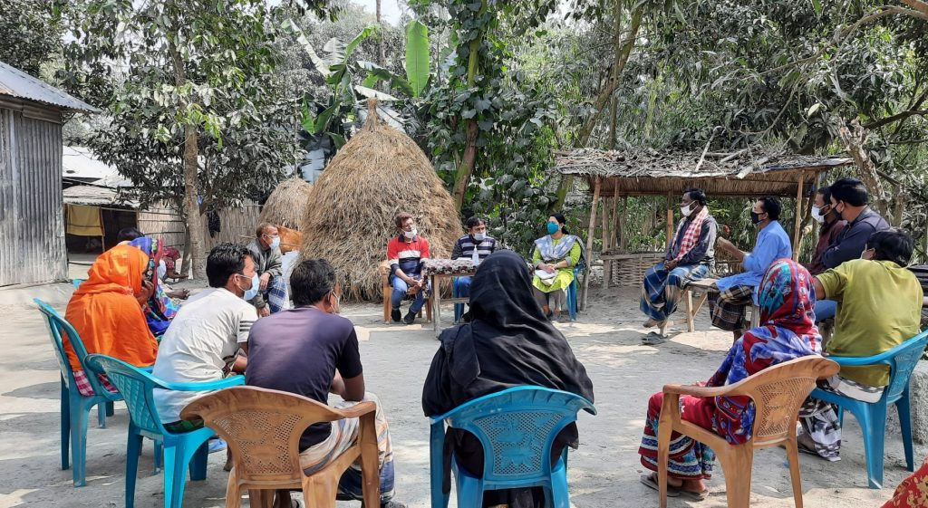 Meeting with members of Community Flood Resilience Action Group, Char Charitabari, Sundarganj. Community groups shared their experience and challenges in building community flood resilience. (Zakia in yellow with blue mask)