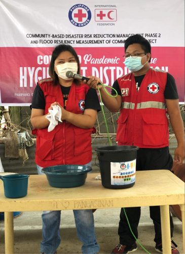 Philippine Red Cross demonstrating the importance of good hygiene practices during floods and to reduce the spread of COVID-19. Photo by Philippine Red Cross