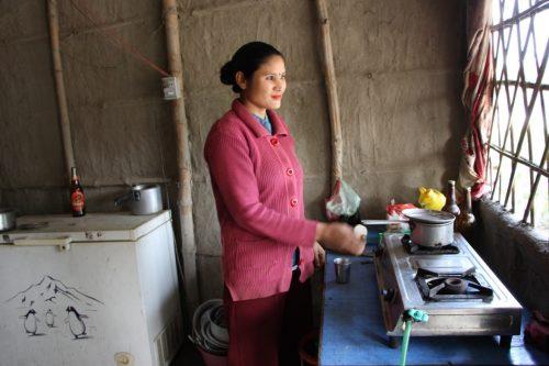 Gita cooking in her fast food restaurant