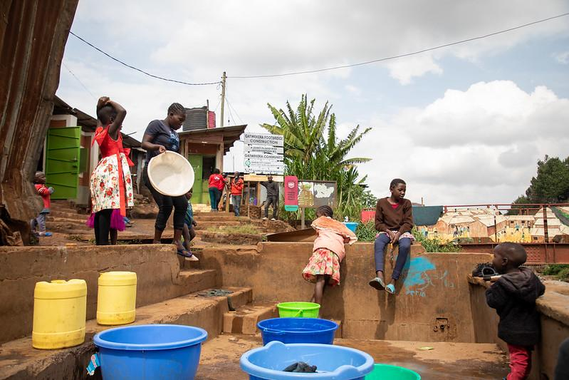 Kibera laundry pad allows women to watch their children while doing their work