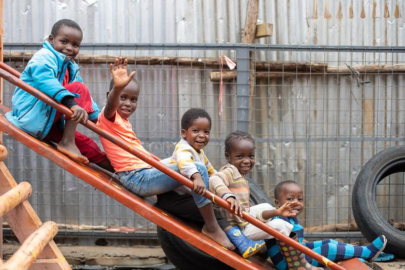 Children play on a slide at a KDI public space.