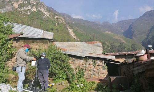 Maintenance of EWS monitoring station. Credit: Practical Action